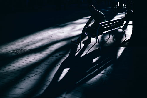 Silhouette of a teenage boy in a dark room