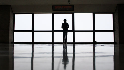 Silhouette in front of a large window